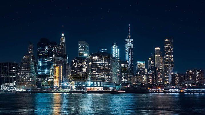 Panoramic view of Manhattan skyscrapers at night